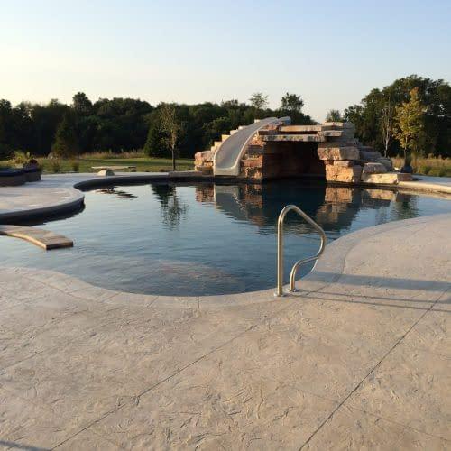 Concrete pool in Iowa City Iowa with slide and white concrete