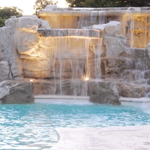 Daytime close up of award winning water fall into pool