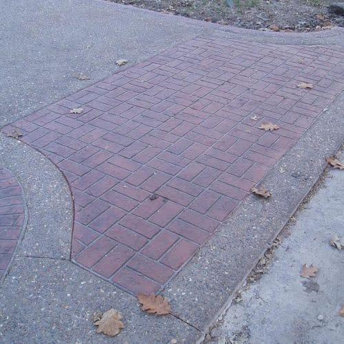Stenciled inlay in servicewalk