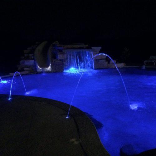 Water fall and laminars in pool at night